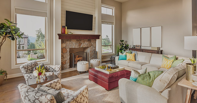 Blackhawk Bank Home Loans, photo of living room with light colored furniture, a fire place and a large window which overlooks the neighbors.