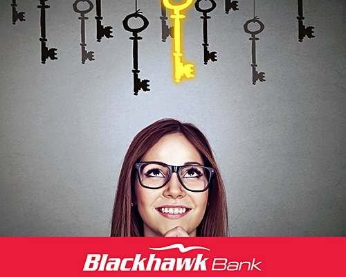 Image of a young woman looking up at a golden key.