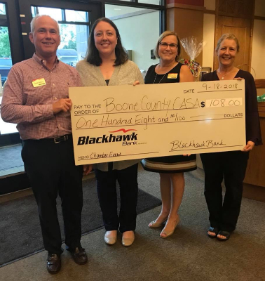 Photo of David Adkins, Charlotte Meier, Donna Schultz and Kim Cooley holding a giant check for $108 made out to Boone County CASA.