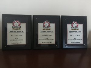 Three What Rocks award plaques