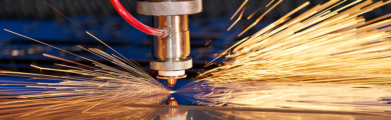 Manufacturing photo, close up of a laser cutter sparking