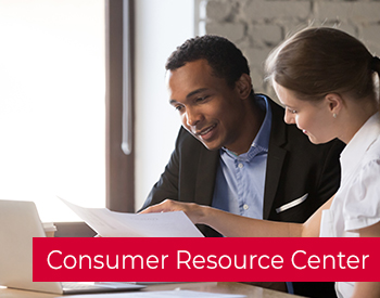 Professional Man and woman looking at papers and computer with wording over the image that reads Consumer Resource Center