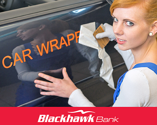Mischievous looking woman next to a car removing tape over the words 'Car Wrapper'